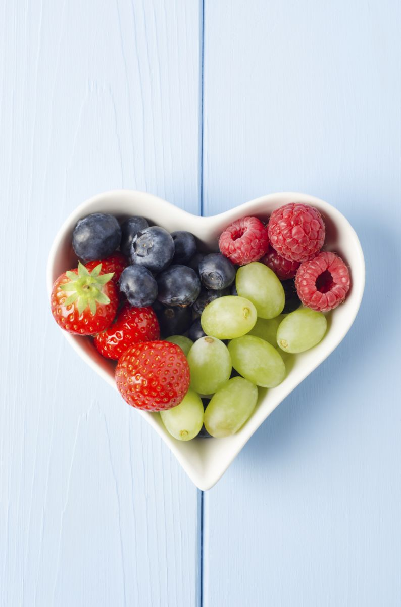 heart shaped bowl with berries and grapes