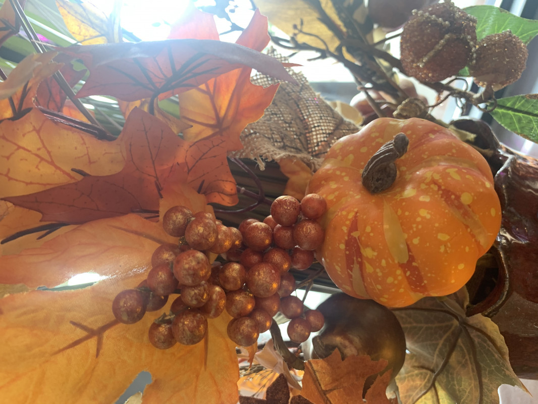 fall tabletop decor - a vase with fall leaves and tiny pumpkins