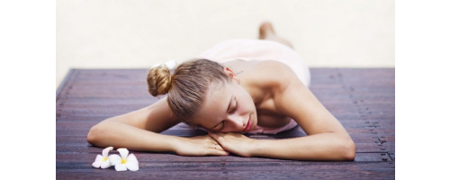 woman lying on hardwood floor
