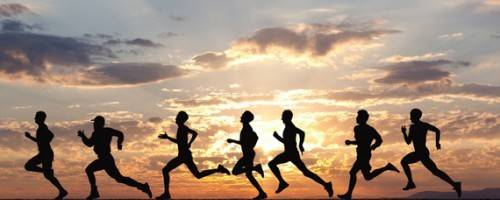group running with beautiful sky background