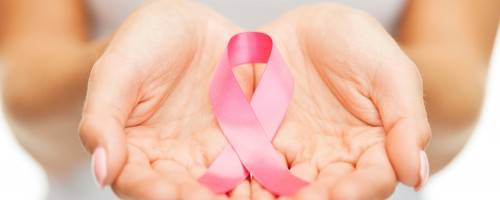 image of breast cancer awareness ribbon in woman's hands