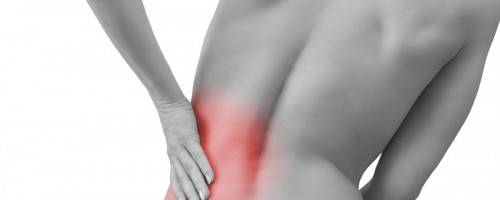 woman with lower back pain, reddened for effect