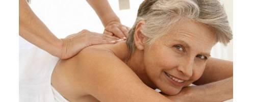 image of mom getting a massage & smiling at camera