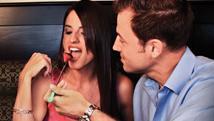 A couple enjoying fondue Logo