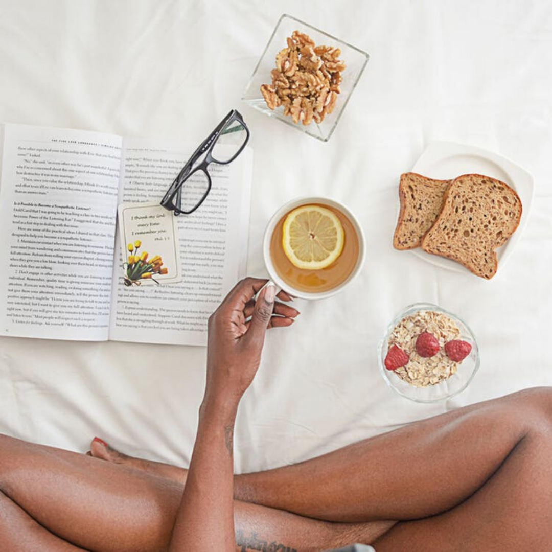 healthy breakfast in bed with a book