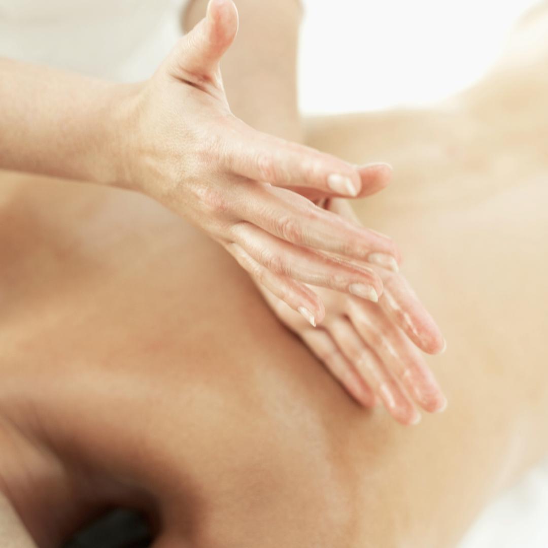 therapist massaging client's back