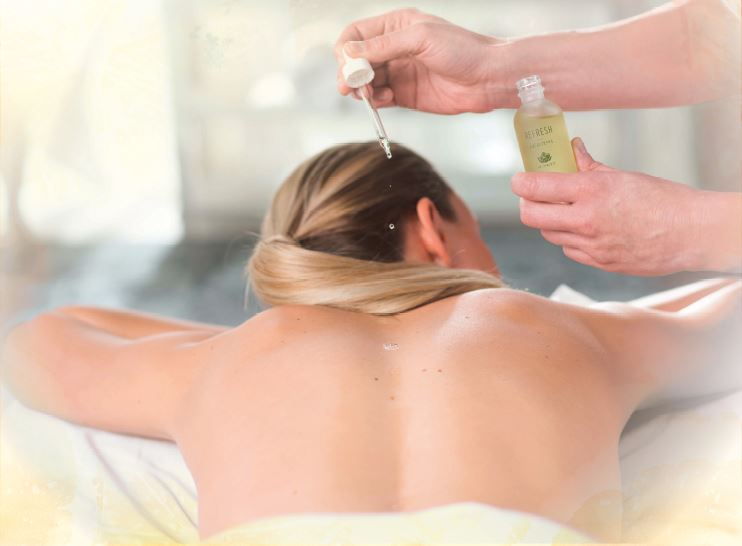 woman getting aromatherapy during massage