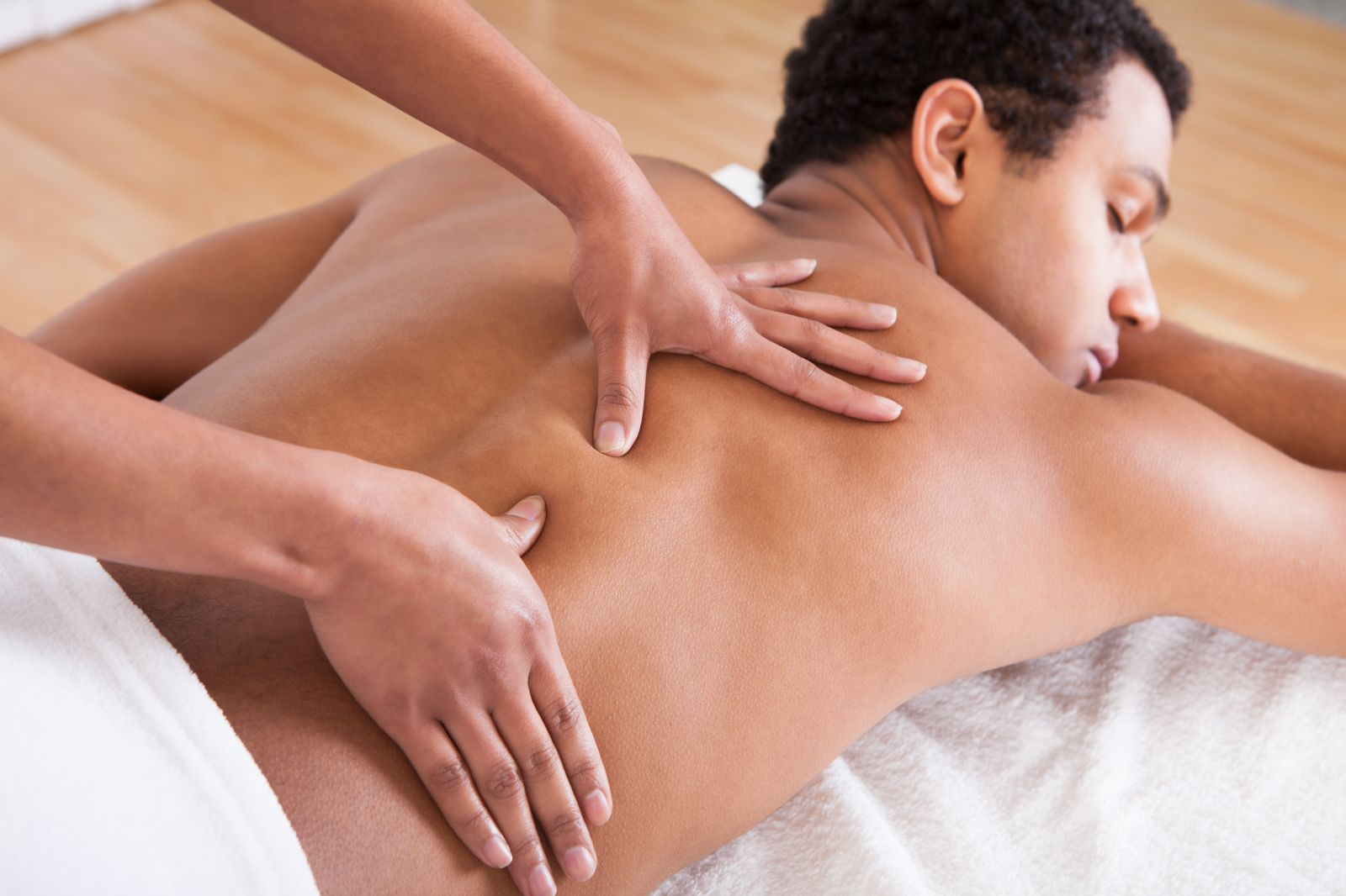 man receiving deep tissue massage at elements massage