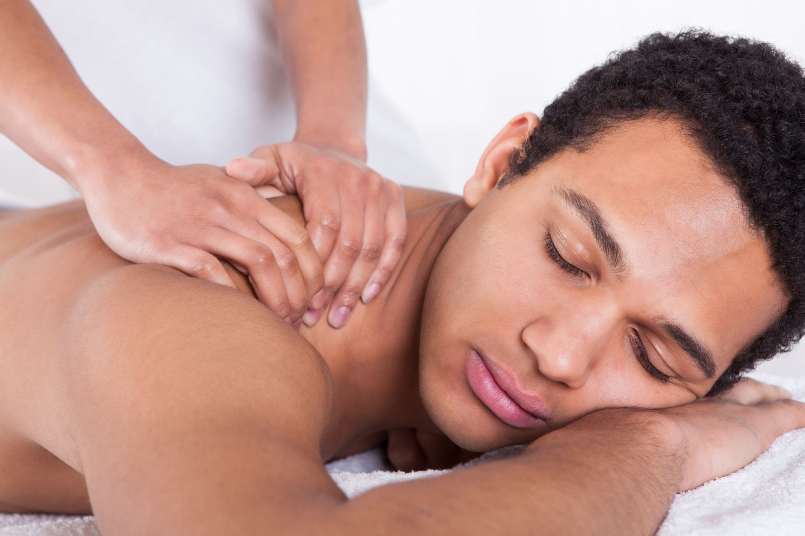 man getting sports massage therapy at elements massage