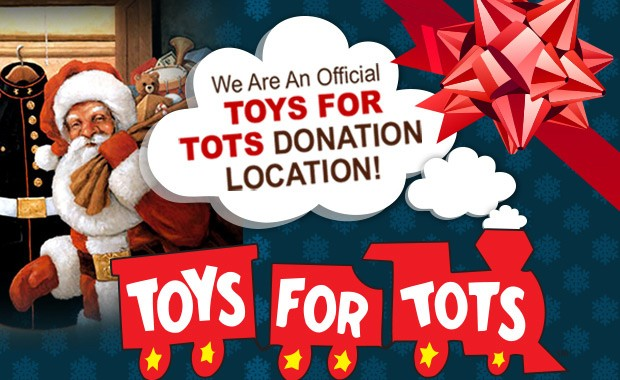 toys for tots train with Santa carrying gifts