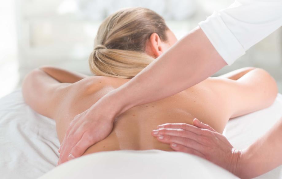 women getting back massage