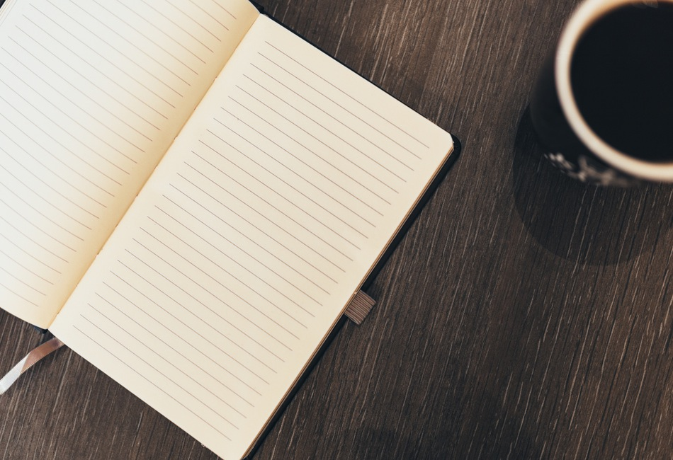 Notebook and coffee cup
