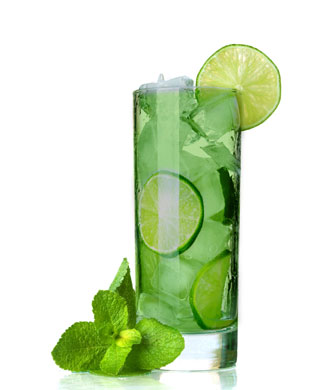 spearmint vodka cooler in tall glass with lime slice