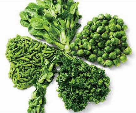 four leaf clover of green vegetables - spinach, green beans, brussel sprouts, and kale